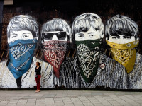 Girl in Front of Beatles Mural by James Jardine (CC BY-NC-ND 2.0) https://flic.kr/p/dbQUCt