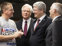 The Prime Minister and I talking with a Ford employee by Terence Young (CC BY-NC-ND 2.0) https://flic.kr/p/dNKunv