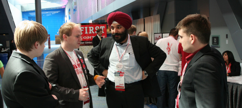 Liberal MP Navdeep Bains (Mississauga--Brampton South) chats with Young Liberals of Canada Vice President Communications-elect Braeden Caley and youth delegates by Michael Ignatieff (CC BY-ND 2.0) https://flic.kr/p/6jzCBK