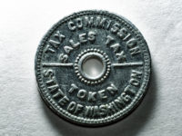 State of Washington Tax Commission Sales Tax Token by Curtis Perry (CC BY-NC-SA 2.0) https://flic.kr/p/dHn6my