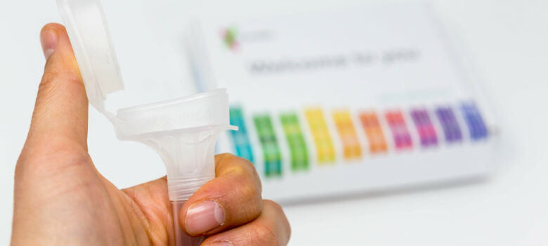 Hand holds Saliva Collection Kit Tube from 23andMe with open funnel lid to test health and ancestry with personal genetic in front of blurry background by Marco Verch https://foto.wuestenigel.com/?utm_source=46741832614&utm_campaign=FlickrDescription&utm_medium=link https://flic.kr/p/2edq7nL (CC BY 2.0)