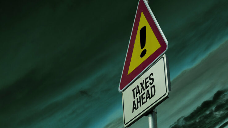 Warning sign of 'Taxes Ahead' by EFile989 http://www.efile.com/ (CC BY-SA 2.0) https://flic.kr/p/mnkQsH