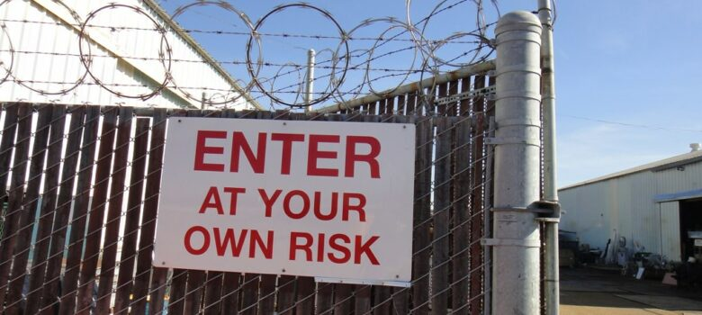 Barbed Wire Cyclone Fence Sign, Enter At Your Own Risk by Lynn Friedman (CC BY-NC-ND 2.0) https://flic.kr/p/9cY2Vt
