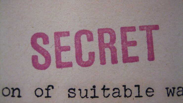 """SECRET"" stamp by RestrictedData (CC BY 2.0) https://flic.kr/p/aCJZrf"